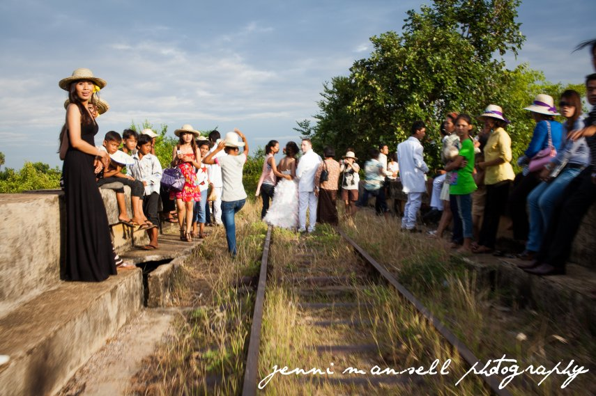 Surprising the bride and groom.  Somewhere in a Cambodian wedding album is a photo of our bamboo train full of Green Mango girls and two Americans waving as we passed the happy couple!