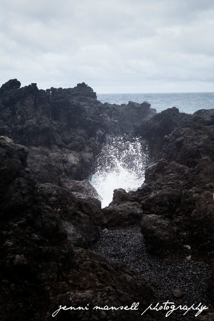 A blow hole in action at Wai'anapanapa Black Sand Beach