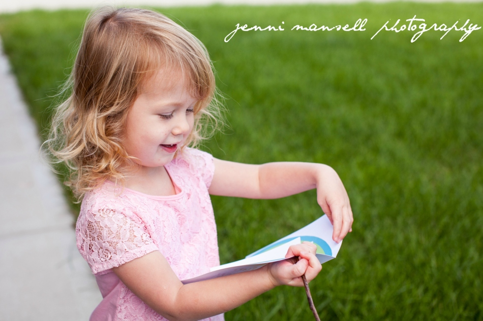 Here is Addison opening a birthday card she got from the mailbox.  :)