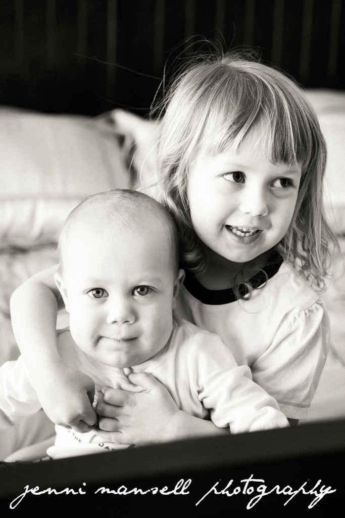 Big sister sneaked in a shot with her little brother!